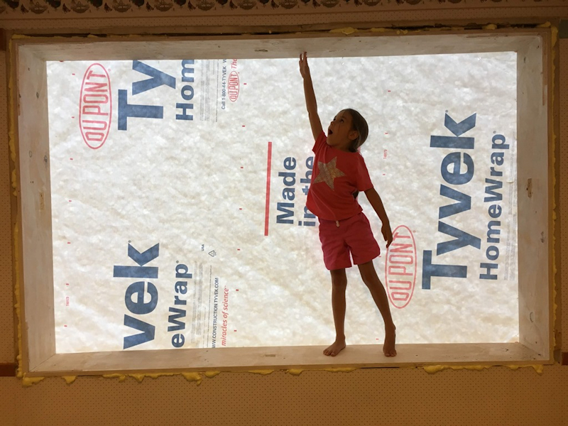 Child in front of insulation